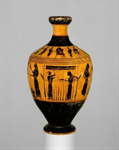Ancient greek vase showing two women working a warp weighted loom.