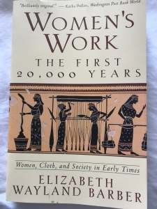 Book cover for 'Women's Work the first 20,000 years by E Wayland Barber.