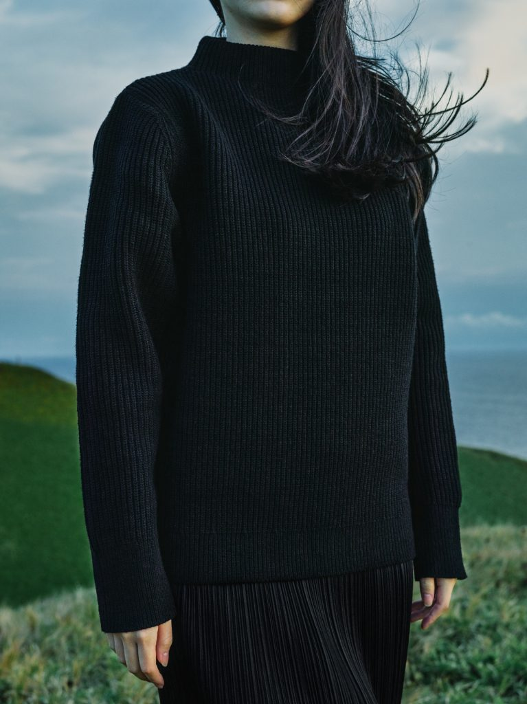 Sweater created using 30% synthetic microbial fibres.