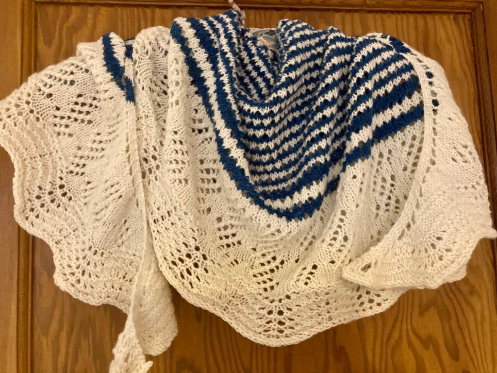 Shawl made using undyed and deep blue wool