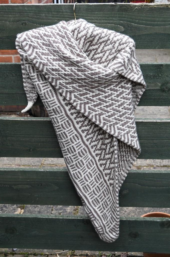 Counterchange DK shawl draped on a hanger.