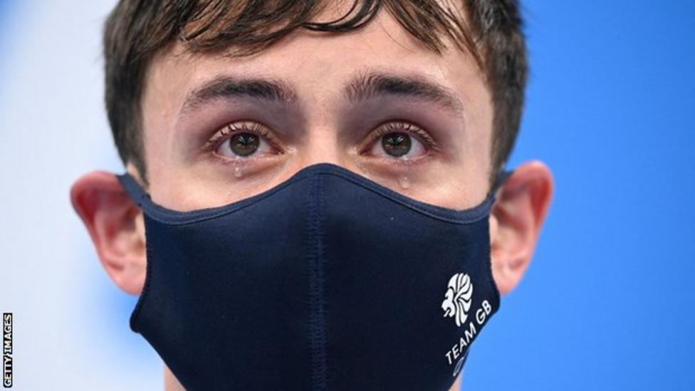 Tom Daley in tears when receiving his gold medal at Tokyo 2021.