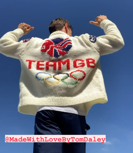 PHoto of a knitted cardigan with the Team GB logo and the olympic rings. Created by Tom Daley.