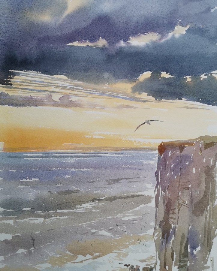 Watercolour painting of Bempton Cliffs in Yorkshire at dawn with an albatroll flying over.